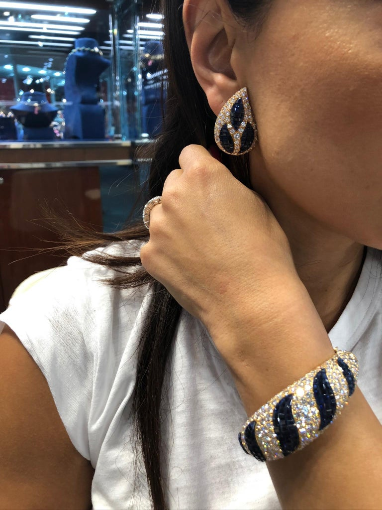 Women's Van Cleef & Arpels Mystery-Set Sapphire, Diamond Bangle and Ear Clips For Sale