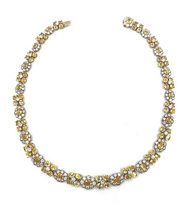 A natural yellow Ceylon sapphire diamond necklace by Van Cleef & Arpels. The necklace is beautifully finished in 18kt yellow gold followed by a pattern of sapphires and diamonds. The necklace is 17.50 in long. The Yellow Sapphire is 65.0 carats and