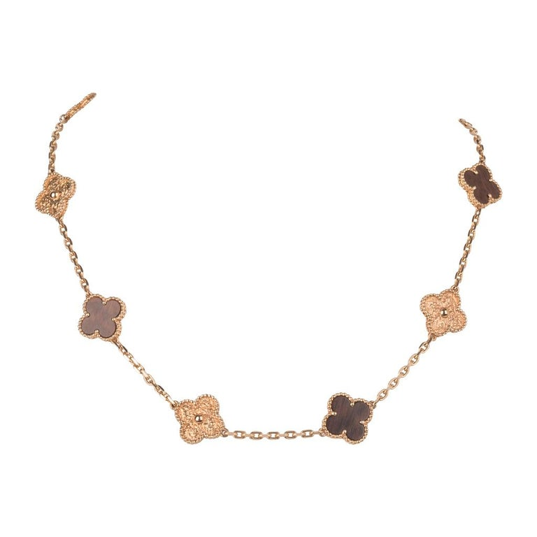 Guaranteed authentic extremely are and highly collectible Alhambra Collection necklace features 18K Rose Gold and Bois d'Amourette (letterwood). Vintage and aged to perfection this series is created by a French craftsman using antique machinery