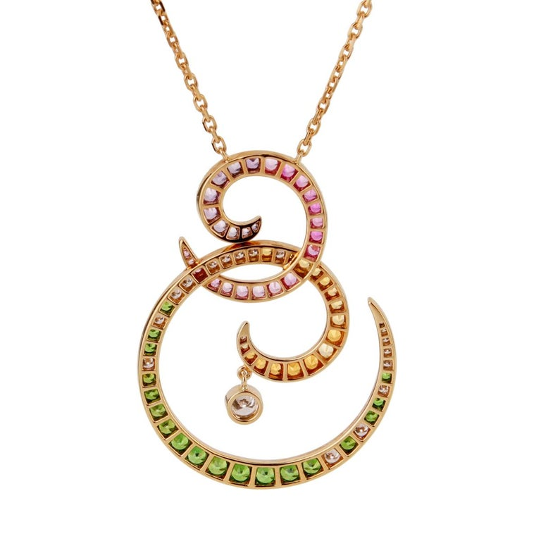 A magnificent Van Cleef & Arpels Oiseaux De Paradis Birds of Paradise necklace showcasing a perfect gradient of multicolored sapphires, and round brilliant cut diamonds. The necklace is crafted in shimmering 18k rose gold and can be worn at 16