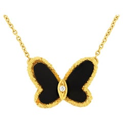 Van Cleef & Arpels Onyx and Diamond Butterfly Necklace
