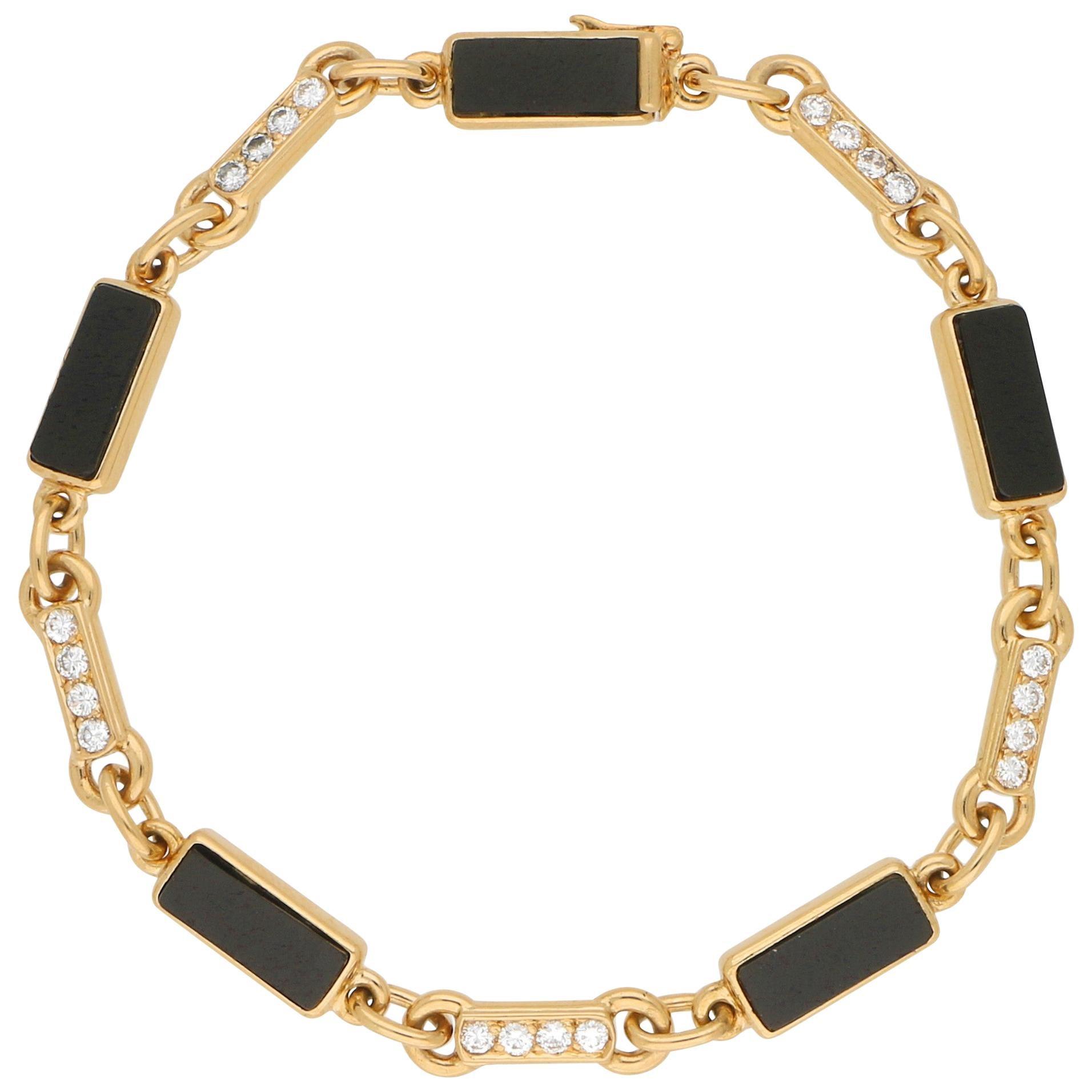 Van Cleef & Arpels Onyx and Diamond Chain Bracelet in 18 Karat Yellow Gold