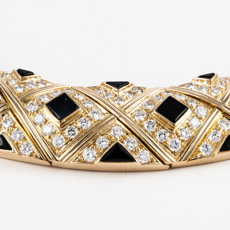 18K yellow gold necklace by Van Cleef & Arpels.  It is a collar accented with onyx and diamonds.  There are seventy-eight (78) round diamonds totaling 5.25 carats; they are F-G in color and VVS in clarity.  Necklace measures 15