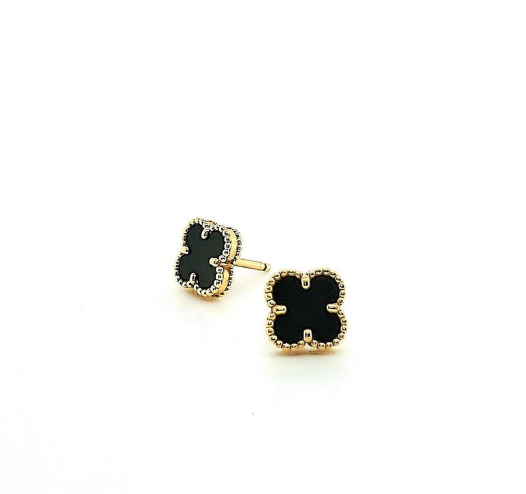 Authentic Van Cleef & Arpels 'Sweet' Alhambra motif ear studs crafted in 18 karat yellow gold and set with carved onyx clovers. The earrings measure 9mm x 9mm. Earrings are signed VCA, Au 750 with serial number. Earring push backs are original. Does