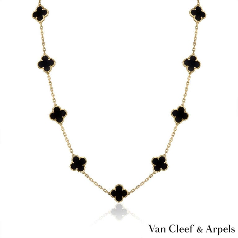 An 18k yellow gold necklace by Van Cleef & Arpels from the Vintage Alhambra collection. The necklace features 20 iconic 4 leaf clover motifs, each set with a beaded edge and an onyx inlay, set throughout the length of the chain. The trace link
