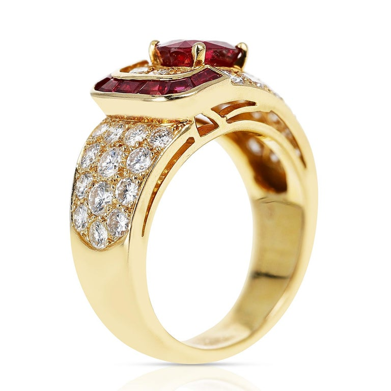 Oval Cut Van Cleef & Arpels Oval Ruby and Diamond Ring with Invisibly Set Rubies, 18k