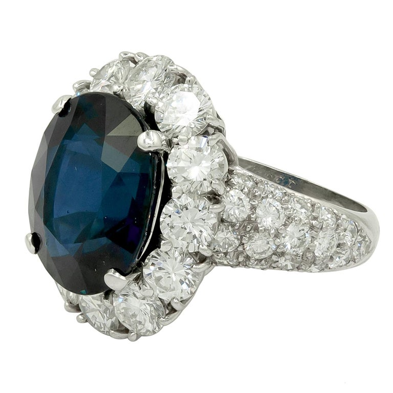 """VAN CLEEF & ARPELS Oval-Shaped Sapphire, Diamond Ring A platinum ring, set with Thailand oval-shaped sapphire, and round brilliant-cut diamonds. Thailand sapphire weight approx. 10.28 cts. with  AGL certificate Signed """"VAN CLEEF & ARPELS""""; circa"""
