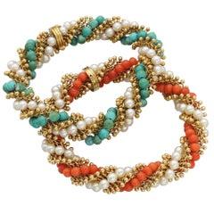 Van Cleef & Arpels Pair of Cultured Pearl, Coral, Turquoise Twist Bracelets