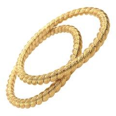 Van Cleef & Arpels Pair of Gold Twisted Bangles