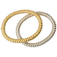 Van Cleef & Arpels Pair of Yellow and White Twisted Gold Bangle Bracelets