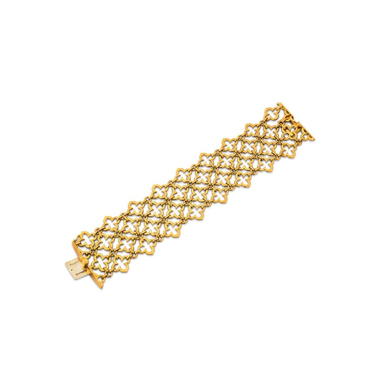 A yellow gold mesh mosaic design of lucky Alhambra clover leaves, makes this Van Cleef & Arpels Paris vintage wide bracelet a sure winner.  With a striking personality, this collectible, comfortable, and one-of-a-kind bracelet is the ultimate in