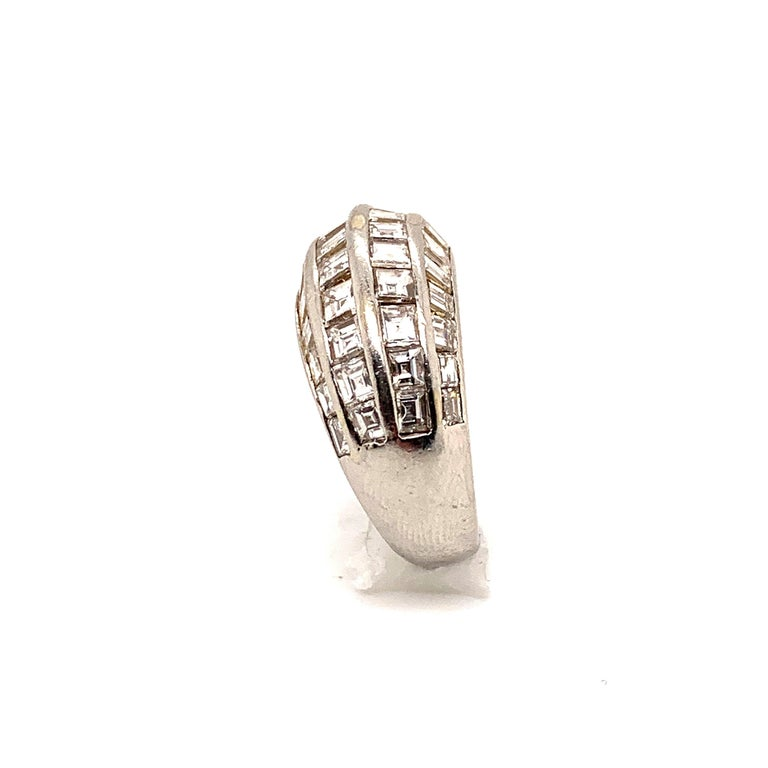 Elegant 1950's Van Cleef & Arpels Paris diamond and platinum bombe ring set with 44 individual baguettes and square French cut Diamonds, for a total carat weight of 4.05 This stunning mid-century ring is stamped, numbered and accompanied with