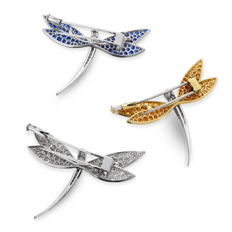 Ephermeral, and illusory, dragonflies have flown the earth for 300 million years and have come to symbolize the ability to overcome times of hardship and are the ultimate omen for good luck.  These three iridescent Van Cleef & Arpels Paris vintage