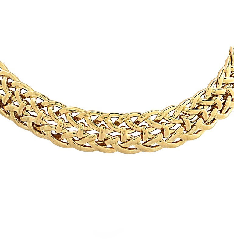 From the legendary House of Van Cleef & Arpels, Paris, this timelessly elegant collar necklace crafted in 18 karat yellow gold, features highly polished yellow gold strands interwoven and bound together with yellow gold details. This classic