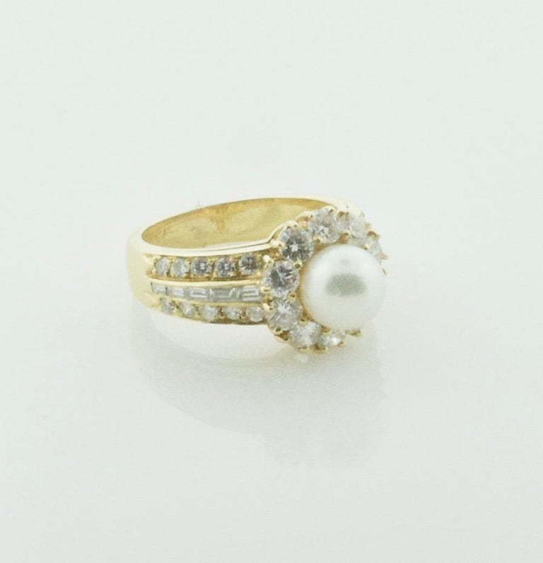 Van Cleef & Arpels Pearl and Diamond Ring in 18k Yellow Gold One 6.5 mm Pearl with GIA Certificate Ten Round Brilliant Cut Diamonds Weighing .80 Carats Approximately  Twenty Round Brilliant Cut Diamonds Weighing .40 Carats Approximately  Ten
