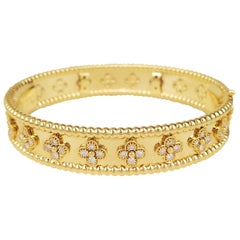 Van Cleef & Arpels Perlée Clovers Gold and Diamond Bangle