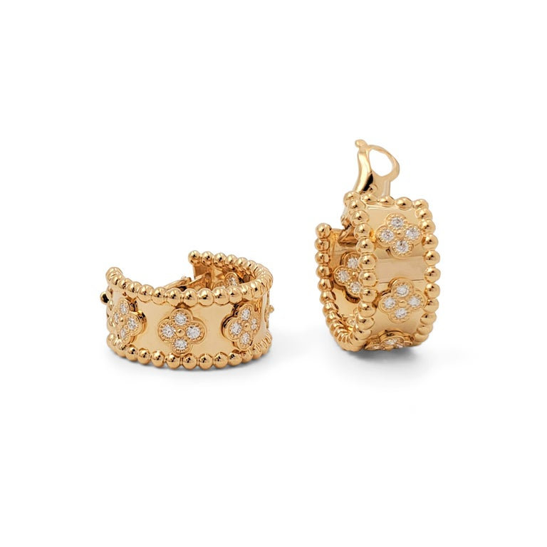 Authentic pair of Van Cleef & Arpels Perlée earrings crafted in 18 karat yellow gold featuring five sections of clovers set with round brilliant cut diamonds (E-F color, VS clarity) weighing an estimated 0.80 carats total. Signed VCA, Au750, with