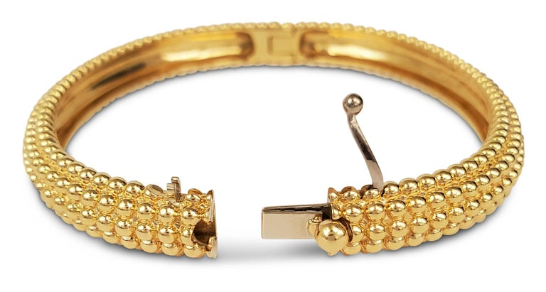Authentic Van Cleef & Arpels Perlée 5-row bangle crafted in beaded 18 karat yellow gold.  Signed VCA, Au750, M, with serial number. Size M (6 1/2 inch diameter). The bangle is not presented with original box or papers. CIRCA 2010s.