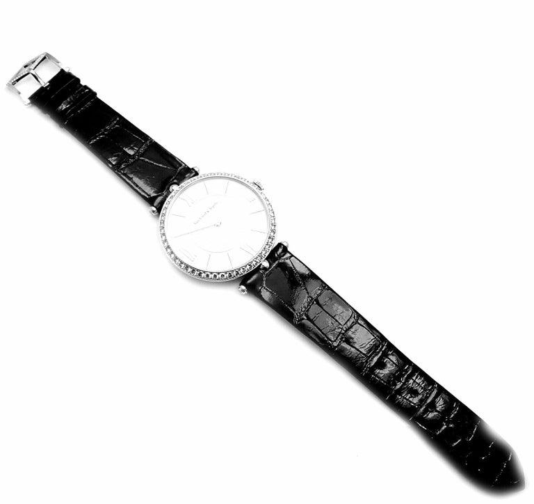 18k White Gold Diamond Pierre Arpels 42mm Wristwatch by Van Cleef & Arpels.  With 49 round brilliant cut diamonds VVS1 clarity, E color on bezel, 4 round brilliant cut diamonds VVS1 clarity, E color on lugs 1 round brilliant cut diamonds VVS1