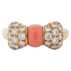 Van Cleef & Arpels Pink Coral and Diamond Bow Ring in 18 Karat Yellow Gold