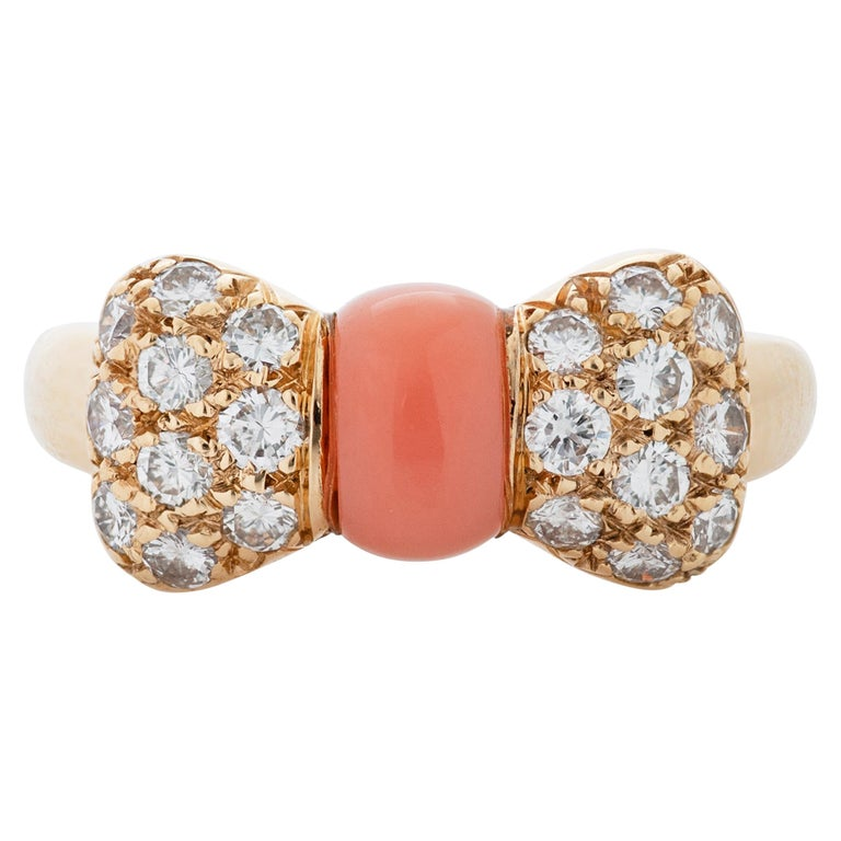 Van Cleef & Arpels Pink Coral and Diamond Bow Ring in 18 Karat Yellow Gold For Sale