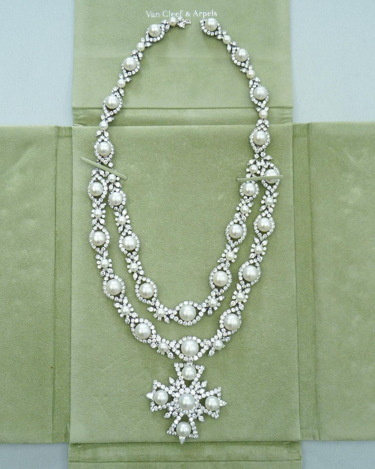 Gorgeous diamond & pearl cross necklace set in platinum and created by Van Cleef & Arpels in 1967.  100 carats multi-shaped diamonds. Necklace and pin are hallmarked.  Necklace is detachable and convertible.   It can be worn as a long two-row