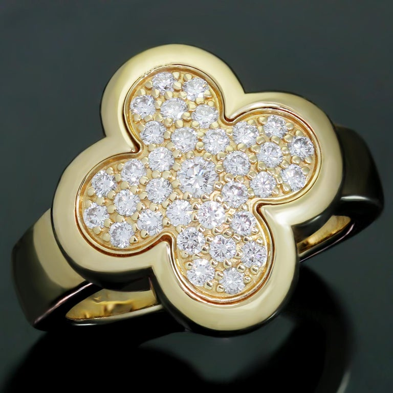 This magnificent Van Cleef & Arpels ring from the Pure Alhambra collection features the lucky clover motif crafted in 18k yellow gold and set with brilliant-cut round D-F VVS1-VVS2 diamonds. Made in France circa 2015. Measurements: 0.62