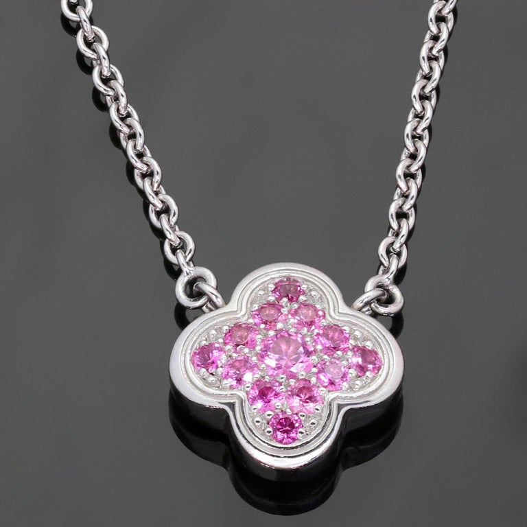 This fabulous limited edition Van Cleef & Arpels necklace from the iconic Pure Alhambra collection features the lucky clover pendant crafted in 18k white gold, set with pink sapphires, and completed with an adjustable length chain. Made in France