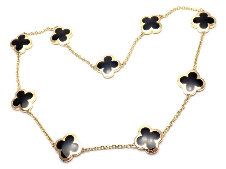 18k Yellow Gold Pure Alhambra 9 Motifs Black Onyx Necklace by Van Cleef & Arpels. With 9 motifs black onyx Alhambra 16mm each Details: Length: 16