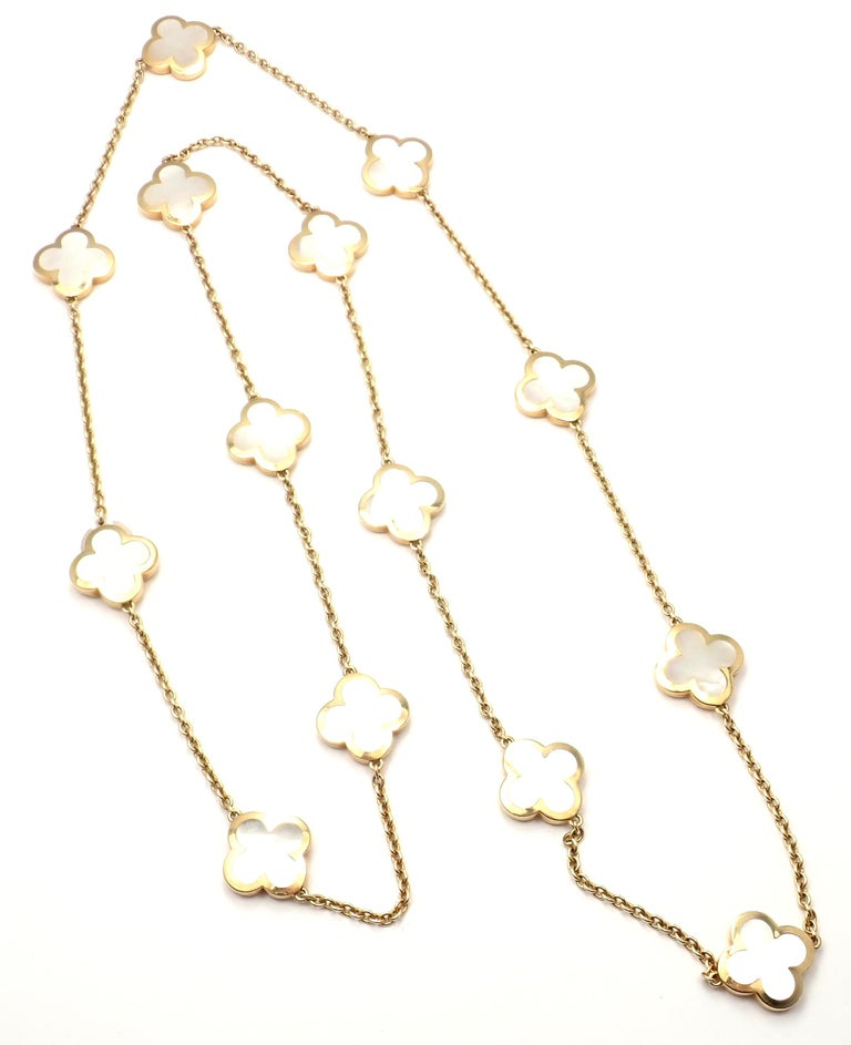 18k Yellow Gold Pure Alhambra Fourteen-Motif Mother Of Pearl Necklace by  Van Cleef & Arpels. With 14 motifs of white mother of pearl pure alhambra stones, 15mm each. Details:  Length: 34