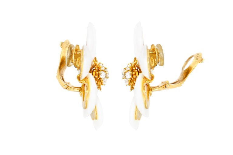 The earrings are finely crafted in 18k yellow gold with diamonds weighing approximately total of 0.72 carat. Measurment: 36x36 Signed by Van Cleef & Arpels.