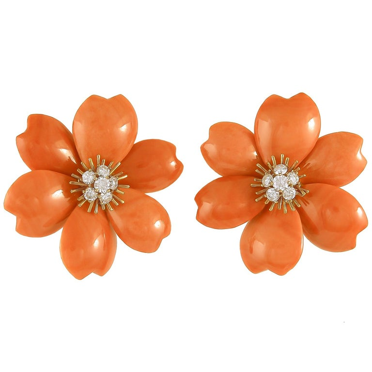 VAN CLEEF & ARPELS Rose de Noel Diamond Red Coral Suite in 18k Yellow Gold. Since the 1970's Van Cleef & Arpels has celebrated the Christmas Rose by preserving the look in an array of hand-carved gemstone petals. This particular suite, which