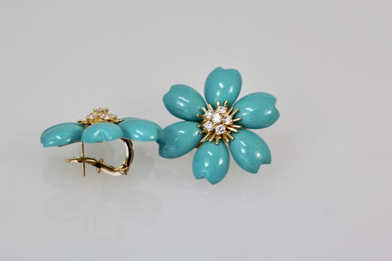 These VCA Rose de Noel Turquoise earrings are rare.  These earrings are Turquoise petals that make up the flowers of these stunning floral earrings. The pair hail from the French firm's highly popular Rose de Noël line, which is underlined by a