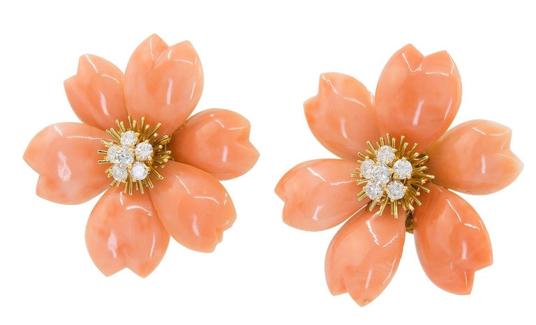 VAN CLEEF & ARPELS Rose de Noël™ Coral Earrings Medium in 18k Yellow Gold. The recognizable 'Christmas Rose', or 'Rose de Noël' by Van Cleef & Arpels fashioned in a rare red coral, with a clustered diamond pistil embedded in a gold sunburst, with