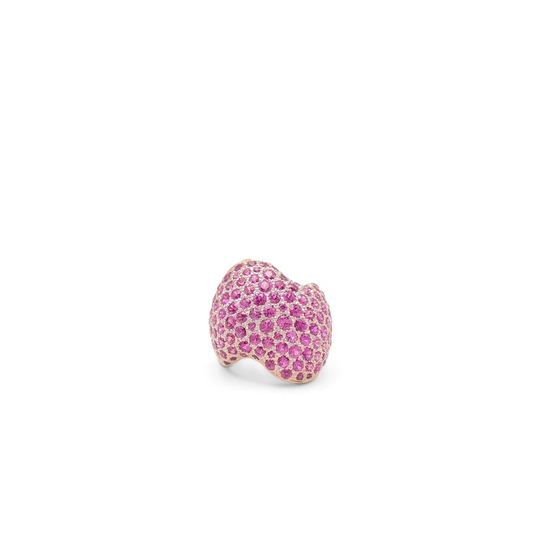 Authentic Van Cleef & Arpels ring crafted in 18 karat rose gold and set with an estimated 6.10 carats of pink sapphires. Signed VCA, 49, with serial numbers and hallmarks. Ring size 49 (US 4 3/4). The ring is presented with the original box and a