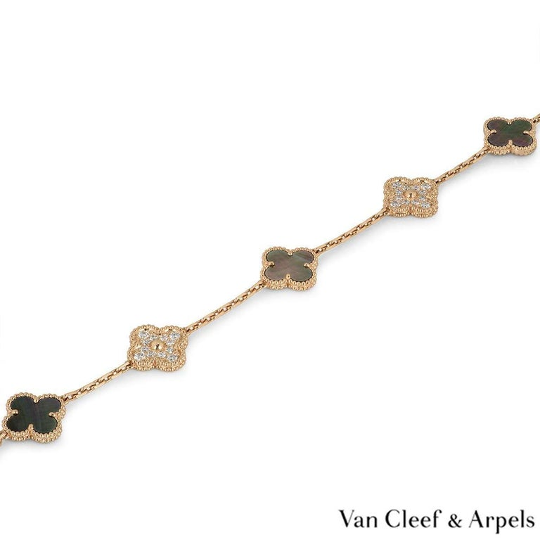 An 18k rose gold bracelet from the Vintage Alhambra collection by Van Cleef and Arpels. The bracelet is made up of 5 iconic clover motifs, three are set with grey mother of pearl and two are set with round brilliant cut diamonds totalling 0.96ct.