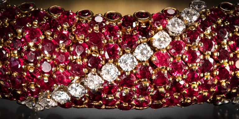 This bracelet represents a best example of Van Cleef & Arpels 1960's collection of articulated bracelets adorned with stripes of rubies and diamonds. It is centrally set with circular-cut rubies, accented by three diagonal rows of brilliant-cut