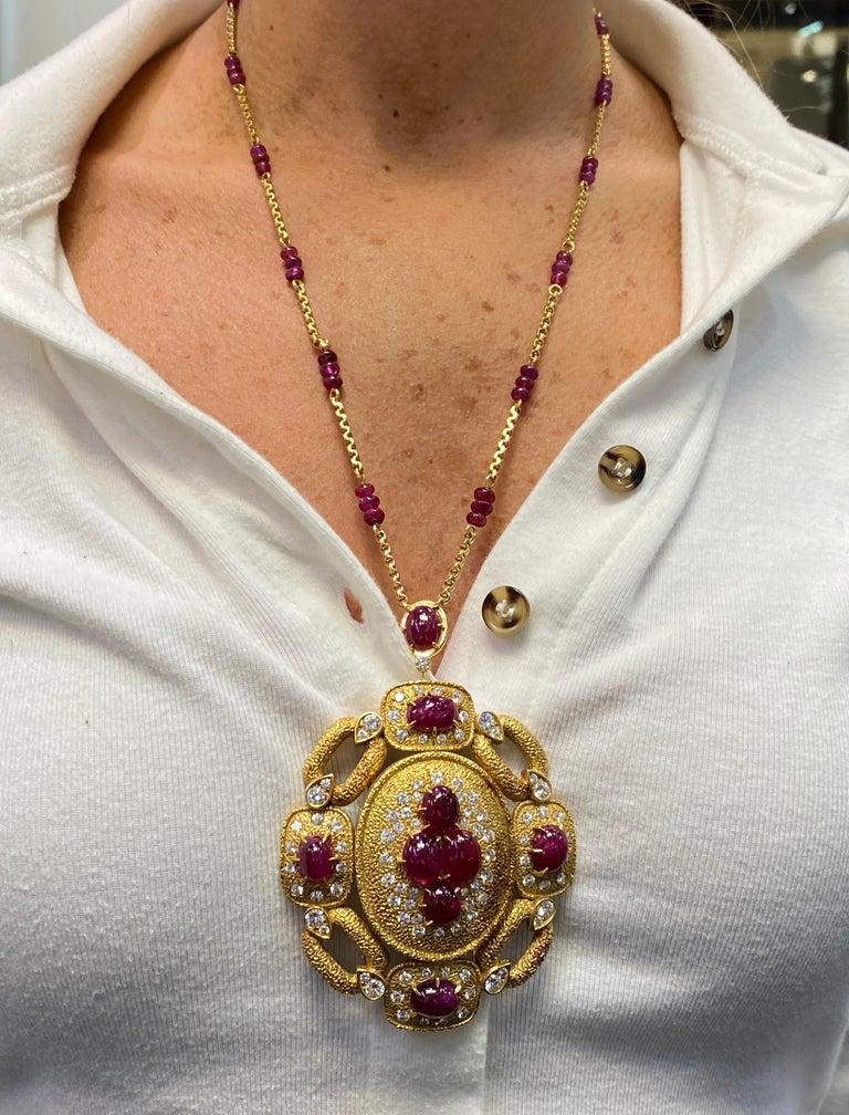 Van Cleef & Arpels Ruby & Diamond Pendant & Necklace Set  18K Yellow Gold.   Pendant converts into a brooch Circa 1970 Both Pendant and Necklace Signed Van Cleef and Arpels and numbered.   Pendant info 8 Natural cabochon rubies & round cut diamonds
