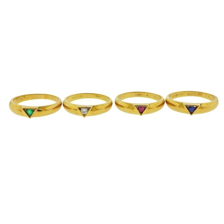 18k yellow gold stackable ring set by Van Cleef & Arpels. Rings feature a single diamond, ruby, sapphire and emerald center stone. Diamond- 0.07ct, Ruby- 0.11ct, Sapphire- 0.11ct, Emerald- 0.09ct. Ring sizes - 6.25 each . Width - 4.4mm (each).