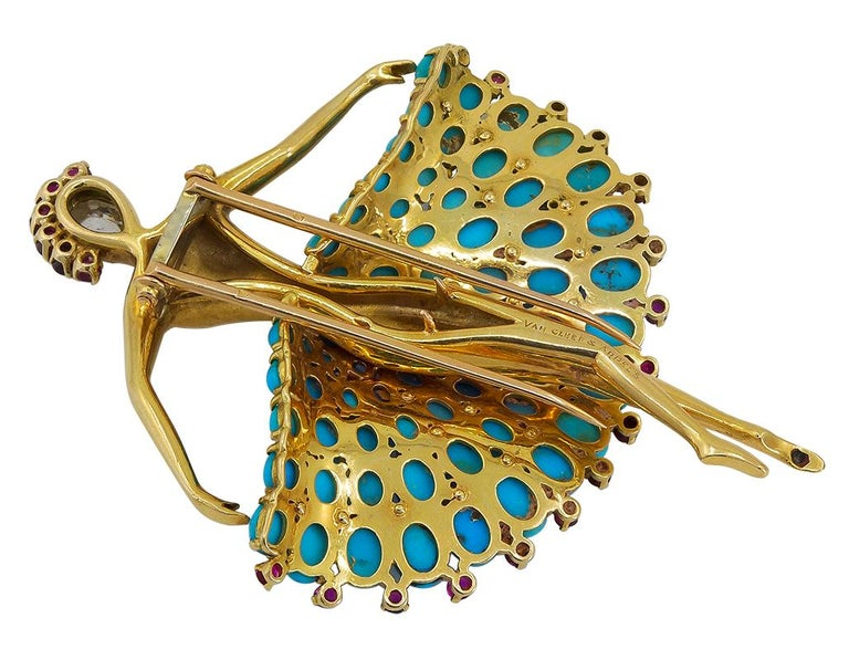VAN CLEEF & ARPELS Ruby Turquoise Ballerina Brooch in 18k Yellow Gold. An important jewel in the Van Cleef & Arpels heritage collection, this jubilant ballerina dates from 1952, when the motif became a symbol of exuberance and hope after World War