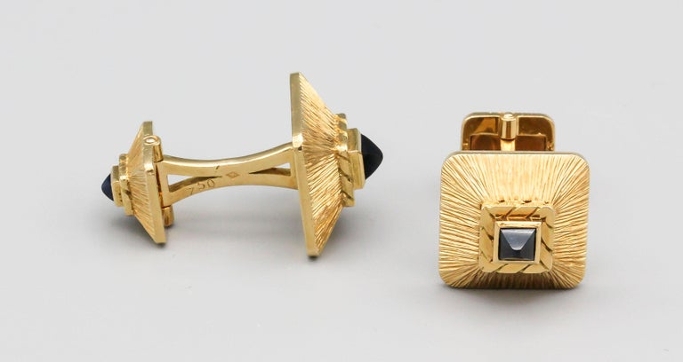 Rare and unusual 18k yellow gold and sugarloaf cabochon sapphire cufflinks by Van Cleef & Arpels, circa 1950-60s.  Of French origin.  Hallmarks:  VCA, 750, reference numbers, French 18k gold assay marks, maker's mark.