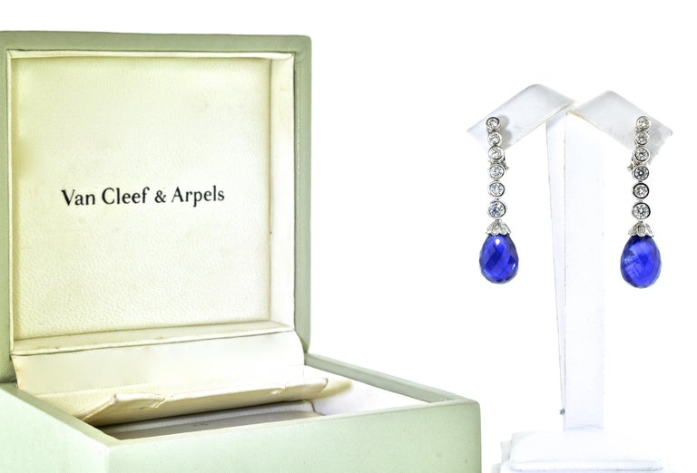 Van Cleef & Arpels earrings possessing two fine faceted briolette natural bright blue sapphires weighing 27.4 cts.  They are well matched and well cut and display a pure bright blue color.  There are approximately 2.5 cts. of fine collection quality