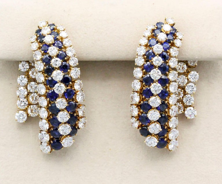 Impressive blue sapphire, diamond and 18K yellow gold ear pendant earrings by Van Cleef & Arpels.  They feature rich blue sapphires approx. 11.00cts, and very high grade round brilliant cut diamonds, approx. 14.90 cts total weight.  Hallmarks: Van