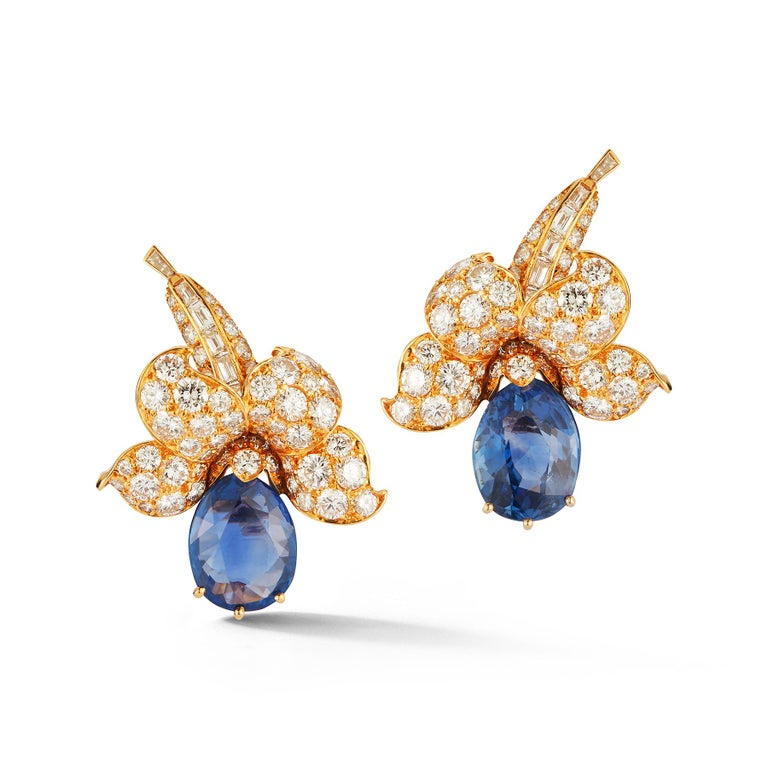 Van Cleef & Arpels Sapphire & Diamond Flower Earrings 2 pear-shaped sapphires; circular and baguette-cut diamonds Back Type: Clip On Signature: Van Cleef & Arpels and numbered 1.37