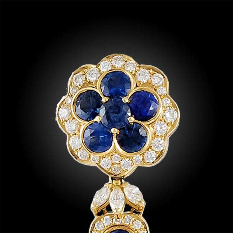 Each pair of earrings suspending a circular-cut sapphire and diamond lozenge-shaped pendant with marquise-cut diamond fringe, a circular-cut sapphire and diamond surmount of similar design, set in 18K yellow gold.  Signed Van Cleef & Arpels Vintage