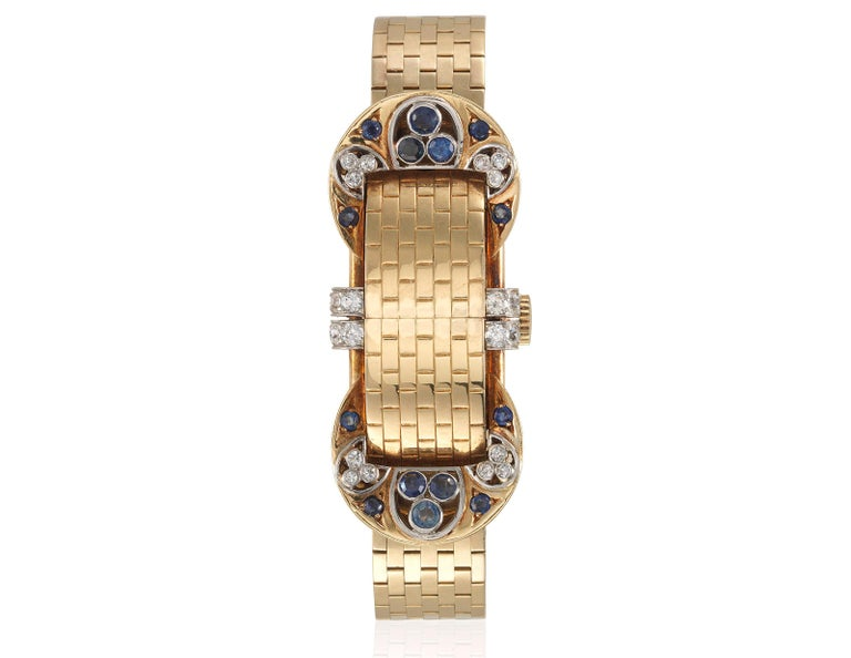 Van Cleef & Arpels Sapphire Diamond Yellow Gold Retro Mystery Watch-Bracelet In Good Condition For Sale In New York, NY