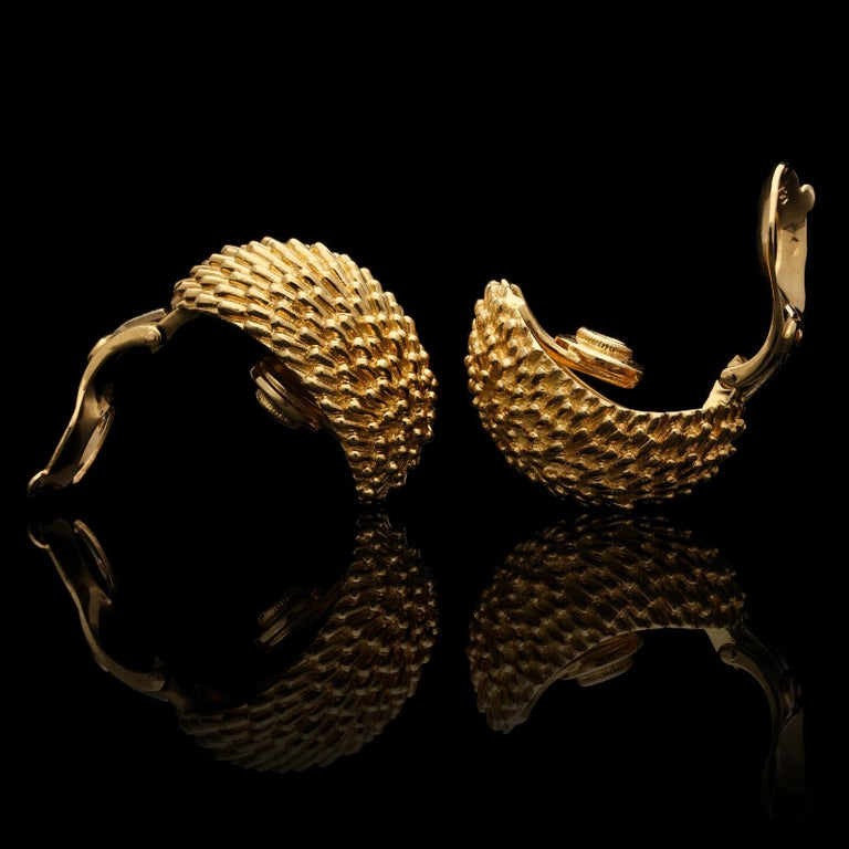 A stylish pair of gold 'Hedgehog' earrings by Van Cleef & Arpels c.1960s, each of oval domed form and covered in gold wire 'spikes' to resemble the spines of a hedgehog, the reverse with clip fittings suitable for unpierced ears. The
