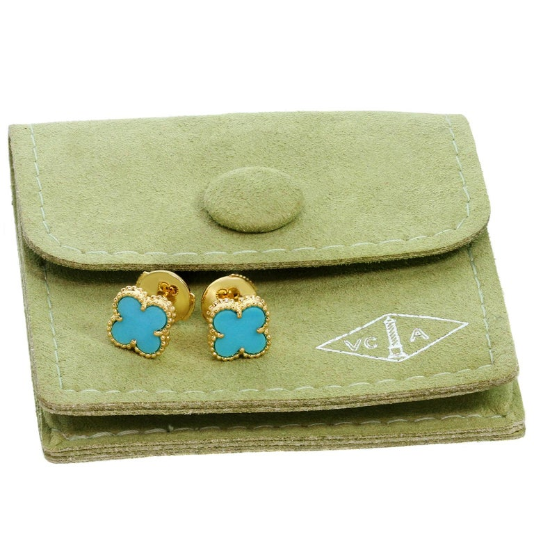 These gorgeous Van Cleef & Arpels earrings iconic Sweet Alhambra collection feature the lucky clover design crafted in 18k yellow gold and set with blue turquoise stones. Made in France circa 2000s. Measurements: 0.35