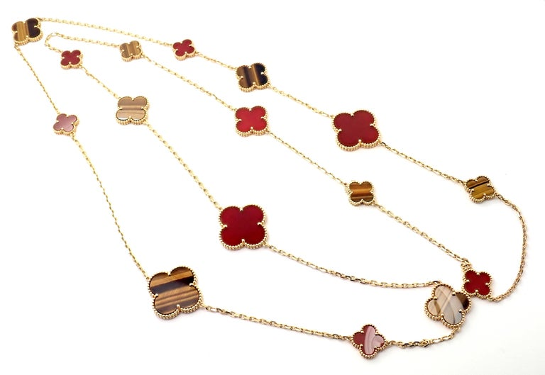 18k Yellow Gold Magic Alhambra sixteen motif necklace with carnelian and tiger's eye by Van Cleef Arpels. Numbered and signed by Van Cleef & Arpels. The Magic Alhambra collection introduces Van Cleef & Arpels' iconic motif in a variation of sizes,
