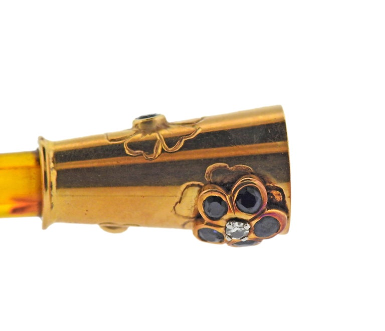 Vintage 18k gold Van Cleef & Arpels cigarette holder, decorated with tortoise and blue sapphires. Measures 3.5